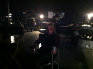 A dark shot of Emppu sitting relaxing between our takes